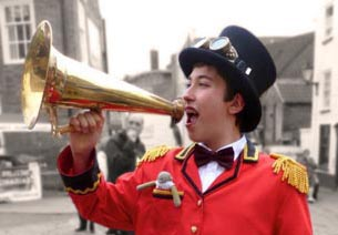 Uniformed boy with brass loud hailer